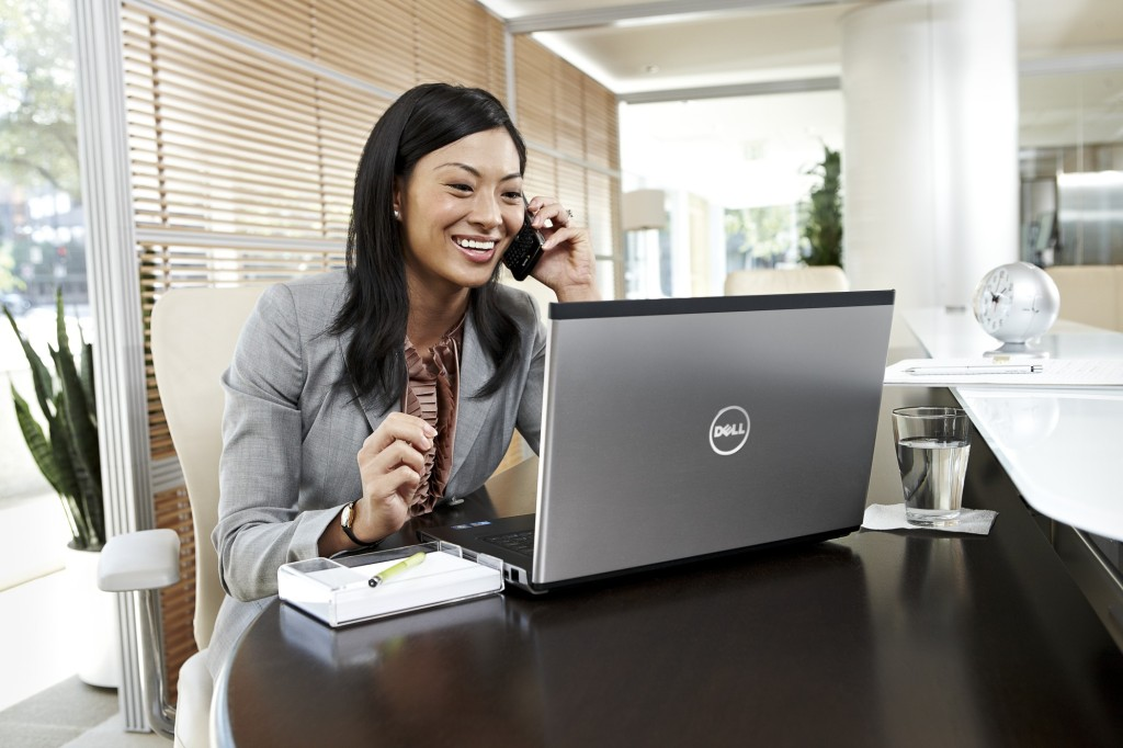 Businesswoman in Office with Dell Products