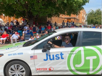 All Smiles inside the JustTech Car at Portsmith River Days